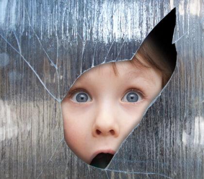 Boy,Looks,Through,A,Broken,Window